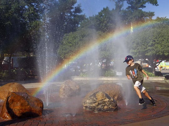 Oliver Carrell, 9, of Des Moines found a misty rainbow one morning at the 2009 State Fair.