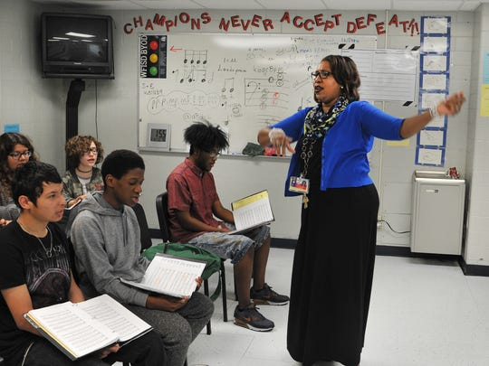 In this file photo, Hirschi High School choir director Mineasa Nesbit, works with her choir class while practicing music they will be singing during the first annual Church, Community, and School Fund Raiser at New Jerusalem Baptist Church last year.