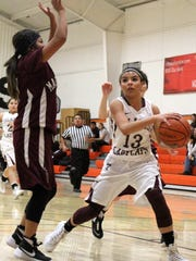 Cassie Vickery, right, tries to score underneath the