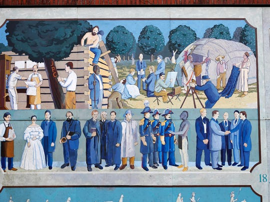 A mural in Founders Park depicts the beginnings of Springfield. Springfield's founder John Polk Campbell can been seen carving his initials into a tree.