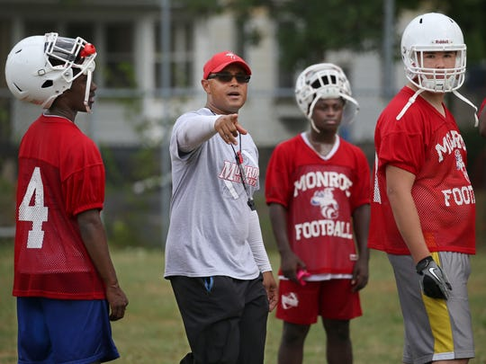 Monroe Head Coach Jason Muhammad guides his squad through punt formations.