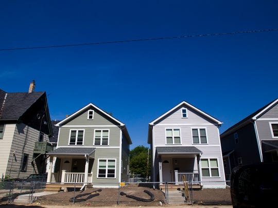 Community Prosecution Units pay attention to problem properties but also support positive properties, such as these two homes in Milwaukee renovated by Habitat for Humanity.