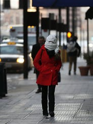 A pedestrian in Cincinnati bundles up during a January