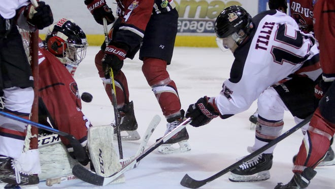 Wichita Falls Wildcats' Steven Tillie attempts a shot that is deflected by the Corpus Christi IceRays goalie Tomas Vomacka Thursday, March 9, 2017, at Kay Yeager Coliseum.