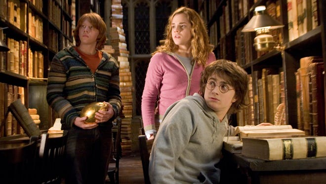 """Ron Weasley (Rupert Grint),  Hermione Granger (Emma Watson) and Harry Potter (Daniel Radcliffe) work on clues in 2005 film """"Harry Potter and the Goblet of Fire."""""""
