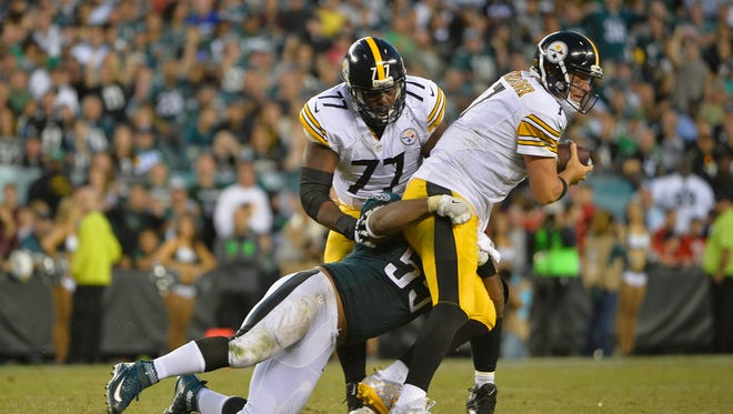 Quarterback  Ben Roethlisberger of the Pittsburgh Steelers is sacked by  Brandon Graham of the Philadelphia Eagles in week four.