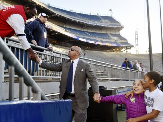 James Franklin's people power helped he and his staff in landing his best recruiting class yet at Penn State. Here, Franklin and daughters Addy and Shola greet Beaver Stadium employees before a game vs. Iowa.