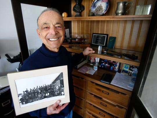 Michael Ricci. the 72-year-old founder of Operation Beachhead, holds one of the few photos he has from his Marines service.