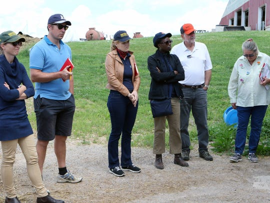 Eleven farmers from around the world were chosen as Nuffield Scholars. The group stopped in Wisconsin for a one day, three-county tour on June 19, including a visit to Never Rest Dairy in Jefferson County where they saw robotic milking.