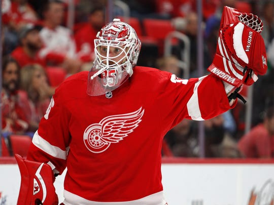 Jimmy Howard signals with his glove during the third period of the Red Wings' 4-2 exhibition loss to the Maple Leafs on Sept. 29, 2017 at Little Caesars Arena.