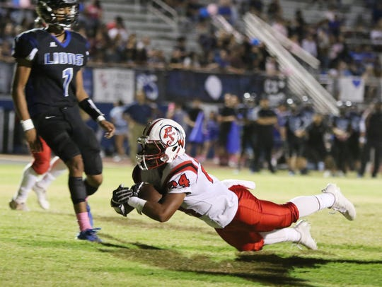 Palm Springs' Jason Roberts dives into the end zone