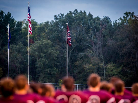 Alex Cullum's No. 56 flag is positioned next to the American flag during the National Anthem prior to Wes-Del's game against Edinburgh at Wes-Del High School.