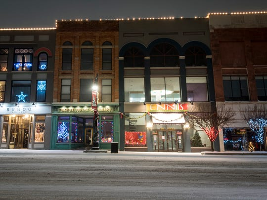 Christmas lights mixed with lights from storefronts light up the street in downtown Port Huron after a snowstorm Dec. 13.