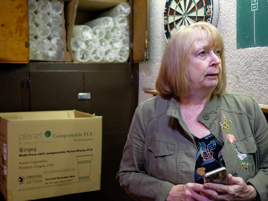 Jennifer Bell, co-owner of The Peanut Barrel in East Lansing, talks about their efforts to use as many compostable products as possible Saturday, June 23, 2018.