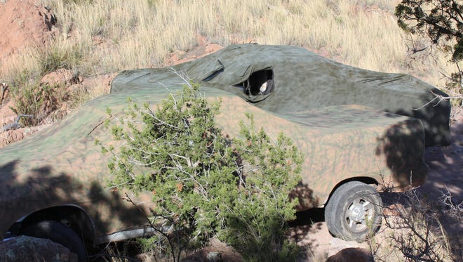 US Border Patrol agents confiscated two pick-up trucks that were concealed in rugged terrain near Animas, NM.