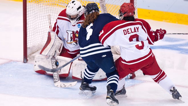 Plattsburgh State goalie Camille Leonard denies Middlebury's Shanna Hickman, center, on a breakaway during the third period of Friday's NCAA Division III women's hockey semifinal in Plattsburgh, N.Y.