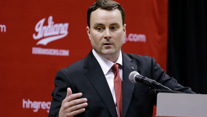 New Indiana NCAA college basketball coach Archie Miller answers a question during a news conference on the court in Assembly Hall after he was introduced in Bloomington, Ind., Monday, March 27, 2017. (AP Photo/Michael Conroy)