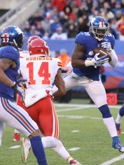 New York Giants strong safety Landon Collins intercepts this Alex Smith pass in the second half.