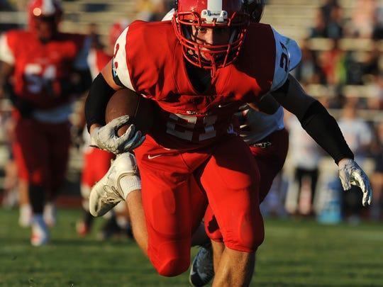 Jeffersonville's Kameron Fuller (21) scores a touchdown