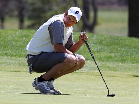 Rumson-Fair Haven's Reid Bedell waits to putt on the