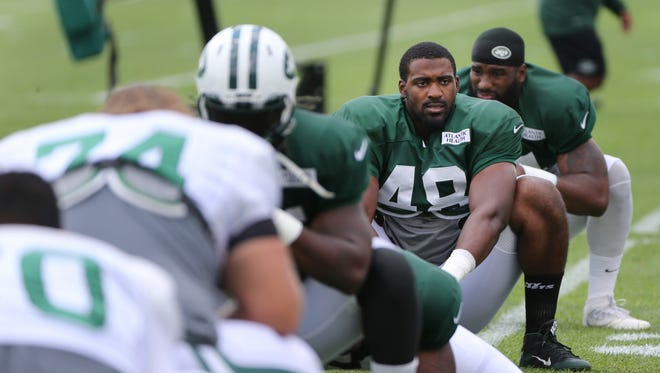 Jordan Jenkins of the Jets stretches during practice at the team's training camp in Florham Park, N.J., Wednesday, Aug. 3, 2016.