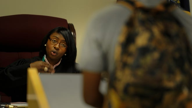 Juvenile Magistrate Jennifer Wade talks to a juvenile during court proceedings Thursday, Aug. 25, 2016, at the Metro Student Attendance Center in Nashville.