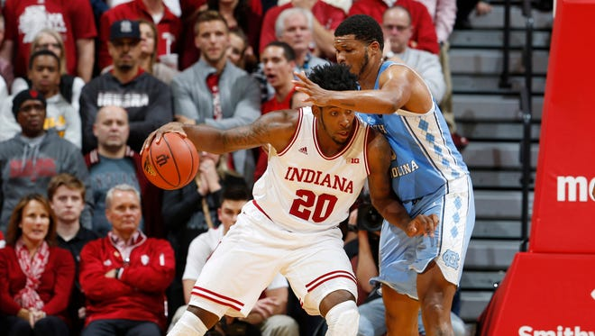 Nov 30, 2016; Bloomington, IN, USA; Indiana Hoosiers forward De'Ron Davis (20) posts up against North Carolina Tar Heels forward Kennedy Meeks (3) at Assembly Hall. Indiana defeats North Carolina 76-67.
