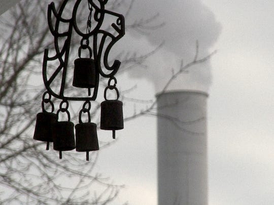 Wind chimes at a home neighboring Mid-America Steel