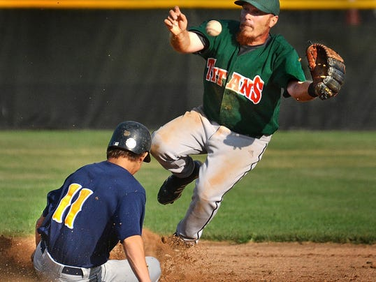 Mount Wolf's Tom Skehan slides safely into second base as Jefferson second baseman Kevin Wisner tries to handle the ball.