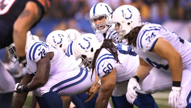 Andrew Luck (12) calls a play behind his line of scrimmage in the first half of their preseason game, August 22, 2015, at Lucas Oil Stadium.