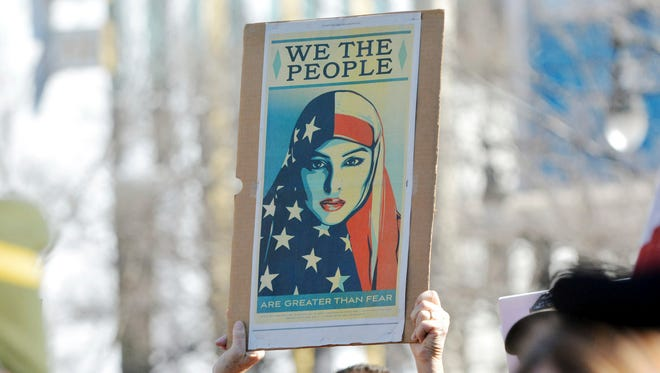 Hundreds of people gathered in Durham, N.C., on Friday to show their support for refugees and immigrants and stand against President Trump's immigrant ban.