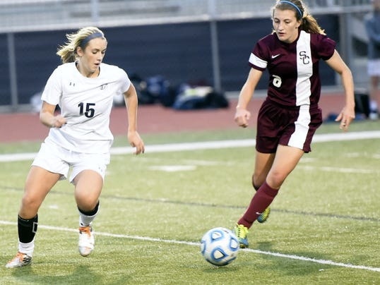 Claire Jacobs of Chambersburg (15) dribbles past Saede Eifrig (8) of State College on Tuesday.