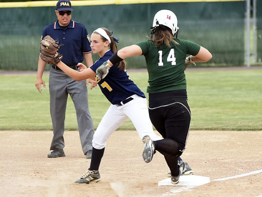 Greencastle's Abigail Reitz, left, gets the out at first base against Kara Duriez, of Twin Valley, on Tuesday during the District 3-AAA semifinals. The Blue Devils lost, 4-2.