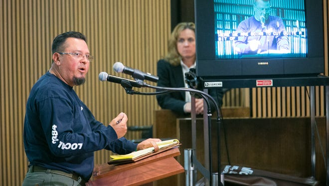 City worker Marshall Pimentel speaks   during a meeting where Phoenix City Council members voted to impose a new contract on the city's police union on May 7, 2014.
