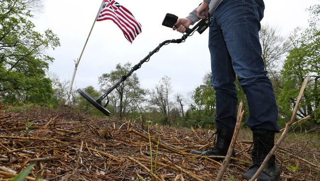 Brad Styple uses a metal detector to search for artifacts in Chatham. Archaeologists have uncovered artifacts from a site in northern New Jersey where American soldiers likely camped during the early part of the Revolutionary War.