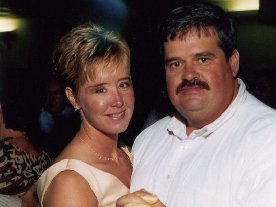 Brandy Hall dances with her husband, Jeffrey, in this undated photo.