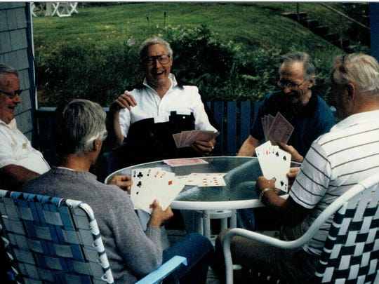 Robert Armitage plays cards with friends in the early 2000s.