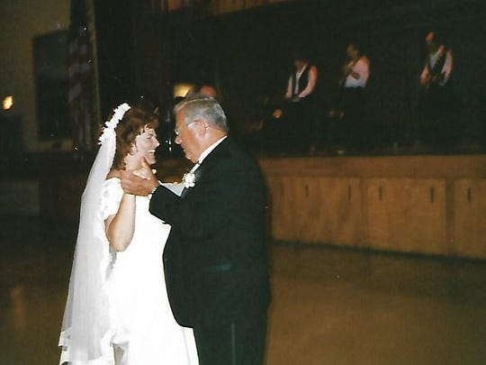 John Stanchak dances alongside his daughter, Laurie, at her wedding.