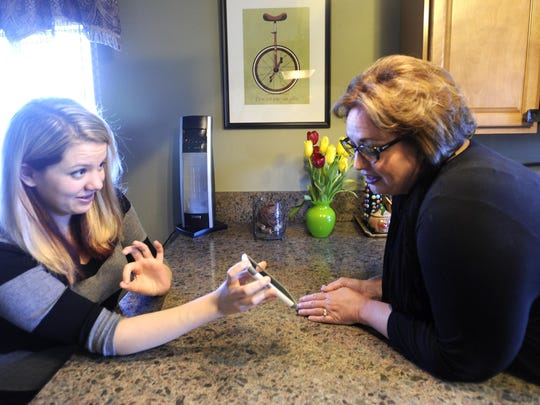 Casey Van Dyke and her mother, Kim, talk about how to use emojis in Madison Heights.
