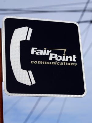 In this 2010 file photo, a FairPoint Communications sign is shown in front of various transmission lines in Portland, Maine.