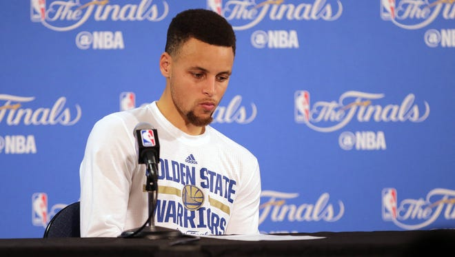 Stephen Curry looks on while speaking to media following a 93-89 loss against the Cleveland Cavaliers in Game 7 of the NBA Finals at Oracle Arena.