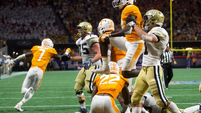 Tennessee players celebrate after winning the Chick-fil-A Kickoff Game at the Mercedes-Benz Stadium in Atlanta on Monday, Sept. 4, 2017.