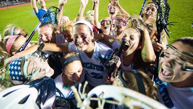 The Stephen Decatur girls lacrosse team celebrates winning the Bayside Title against Queen Annes' on Tuesday evening at Wicomico County Stadium.