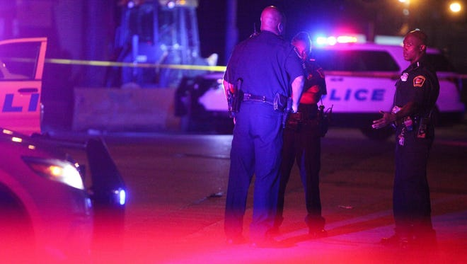 Police investigate a shooting in the West End Friday night.