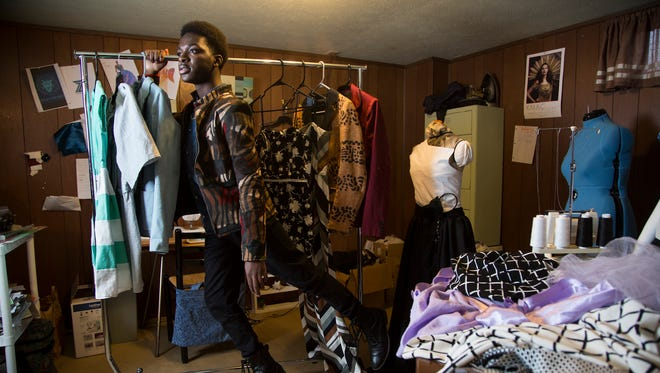 """Clothing designer Zach Lindsey, 16, poses for a portrait in his basement studio. He recently appeared on the first season of """"Project Runway Junior"""" and will soon launch his own fashion line."""
