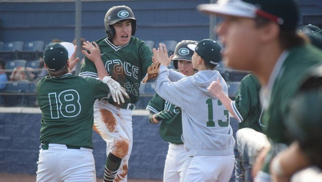 Grace Christian's Josh Gann (98) celebrates with teammates after scoring a run against Barbe in 2016.