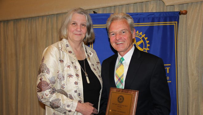 In the photo, Eddy Godfrey receives the 2016 4-Way Test Award from Audrey Orr, President, Rotary Club of Salisbury. The award provided since 1963 to an individual who exemplifies the tenets of Rotary's 4-Way Test, is the Rotary Club of Salisbury's most prestigious civic award.