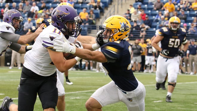 Augustana's Matt Wagner attempts to stop Brent Esser of Minnesota State during Saturday's Homecoming game in Sioux Falls.
