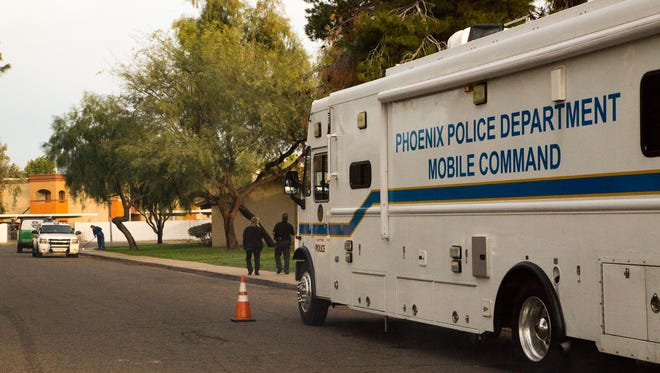 Phoenix police crime-scene response teams finish clearing the scene of a shooting near 33rd and Northern avenues that killed one teen and critically injured another on Feb. 14, 2017.
