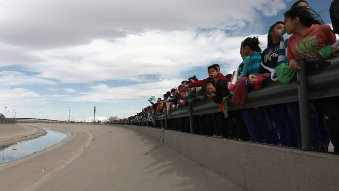 Demonstrators protested President Trump's proposed border wall in February near the site of a cross-border shooting in 2010 between El Paso and Ciudad Juarez, Mexico.